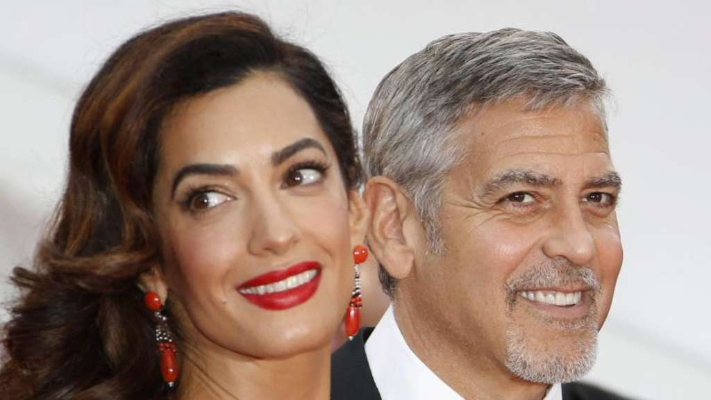 George und Amal Clooney 2016 in Cannes. Foto: Guillaume Horcajuelo